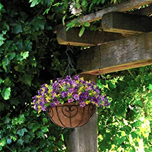 Artificial hanging dark purple daisy flowers in basket for outdoor decor