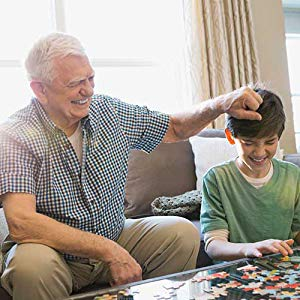grandpa playing games with grandson