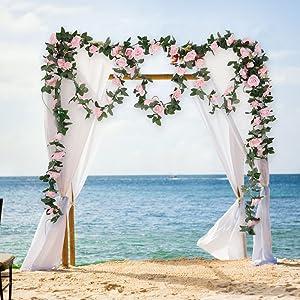 wedding arch with rose vines garland