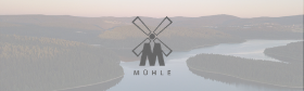 MÜHLE Logo over the mountains