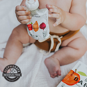 baby holding food