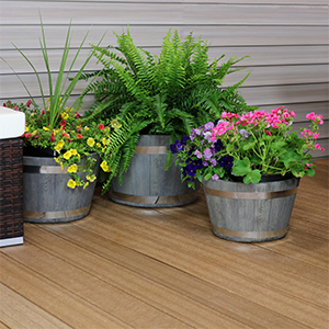 Outdoor traditional modern fiber clay pottery sturdy flower pot planter set shown in use