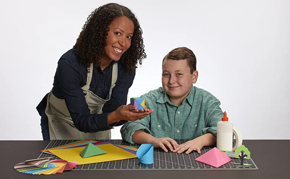 A teacher crafting with her student using Clear Path Paper.