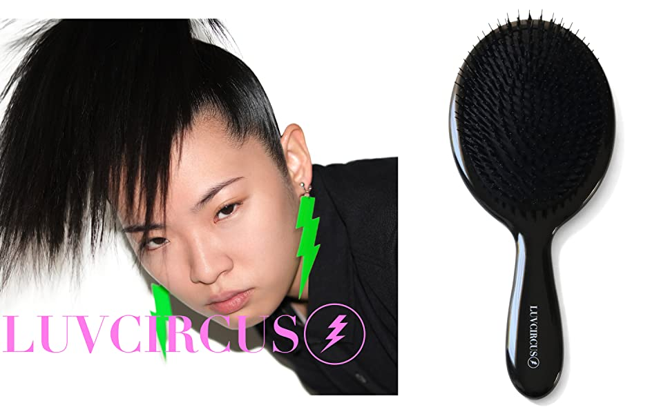 a female model with a shiny ponytail next to a black LUVCIRCUS 001-HAIRBRUSH. rt5