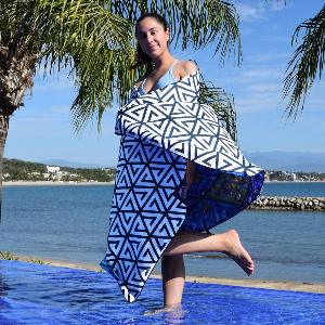 girl standing in the pool with a microfiber towel wrapped around her
