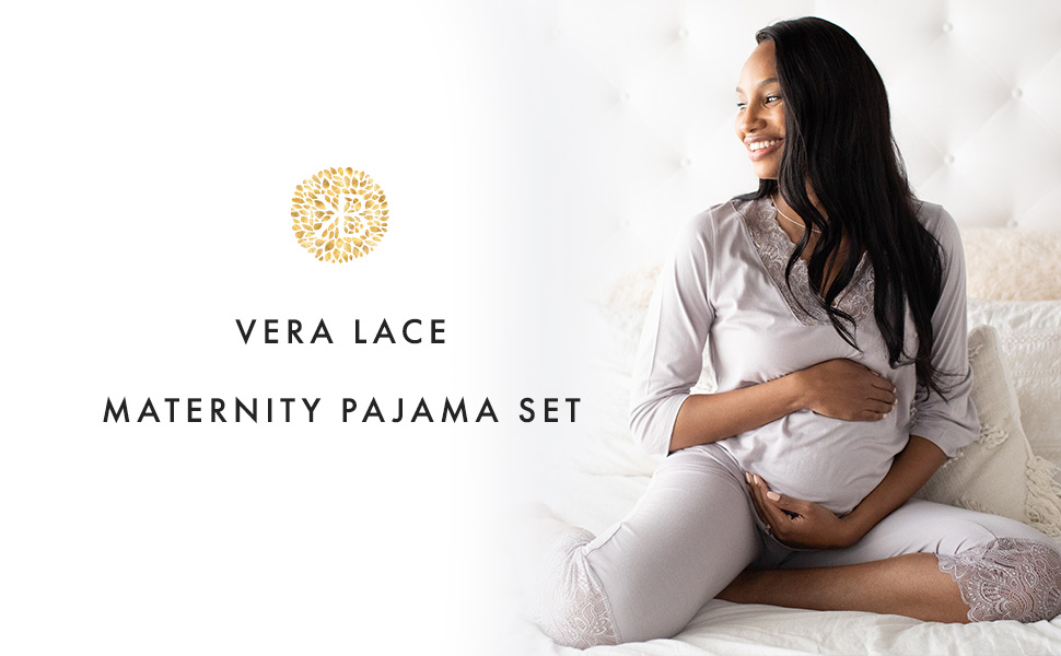 Woman wearing maternity jogger pants and cuddling baby on bed