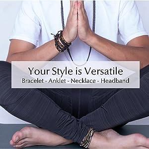 Male model wearing Spirit Wrist as an anklet, bracelet an necklace sitting cross legged