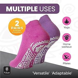 Pink and purple yoga socks on tip toes showing Pakari base pattern