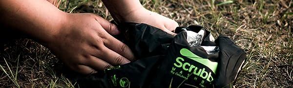 Scrubba black bag in use