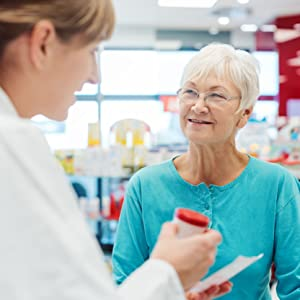 pharmacist and patient discussing pills and medicine