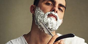 man shaving in mirror bib and tucker