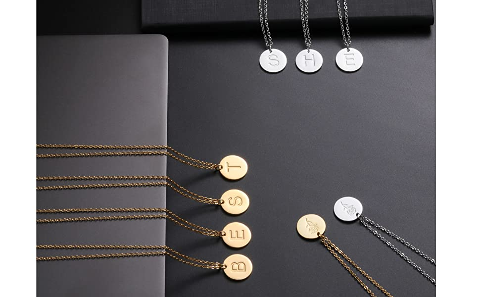 A dainty lowercase initial pendant necklace.