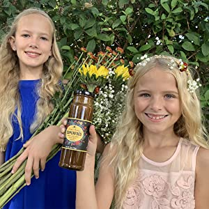 girls holding flower powered superfood with royal jelly propolis and bee pollen