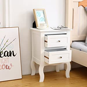 White bedside table showing drawer storage