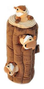 Studio image of chipmunks in log