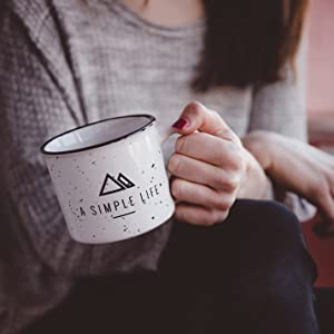 Female sitting cross-legged holding a coffee cup