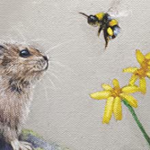 a pika and a bumblebee close up