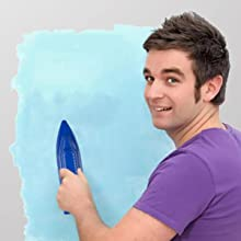 a boy using one piece of the paint pad