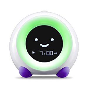 Bright Purple MELLA Sleep Trainer on Wake Mode with Green Light