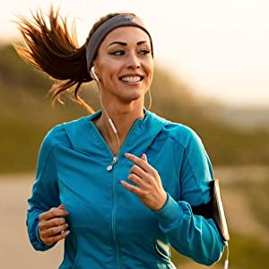 Fit attractive woman jogging