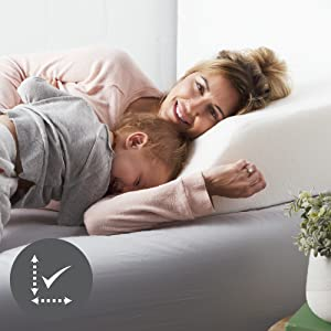 Woman with kid and resting on the wedge pillow