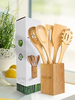 A set of bamboo kitchen utensil set with holder are placed on the kitchen table