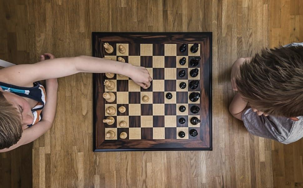 Kids enjoying a game of chess