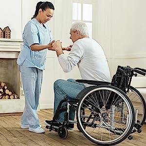 caregiver patient wheelchair helping caretaker nurse