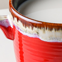 the effect of reactive glaze in the mug opening