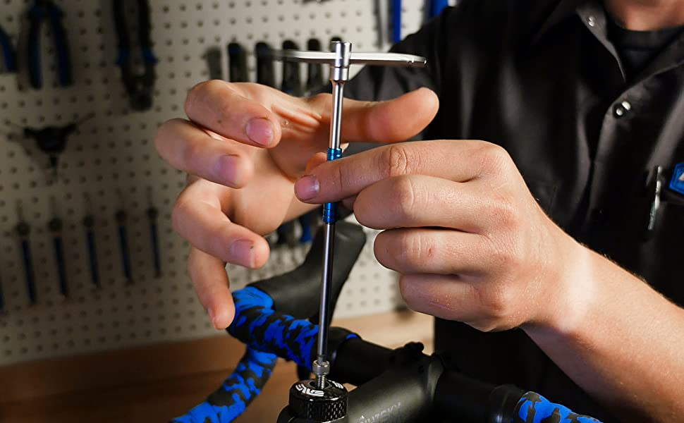 Park Tool THH-1 spinning stem cap bolt into place