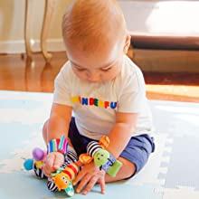 Baby playing with butterfly bug on foot finder sock