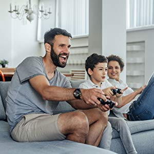 Family playing video games together on the couch