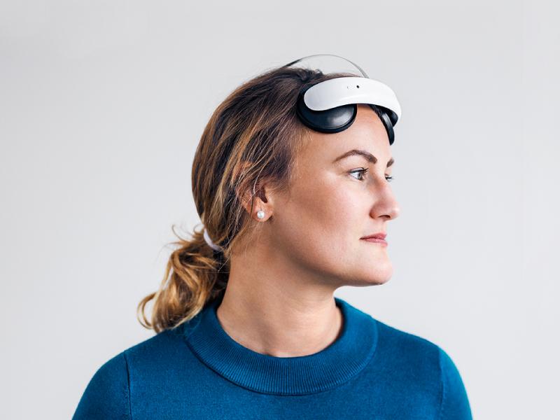 Woman wearing Flow headset