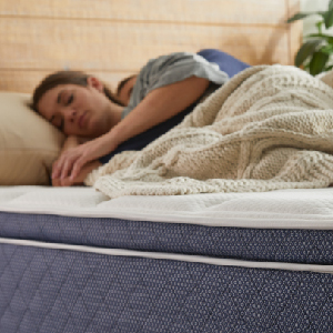 Woman sleeping on the mattress
