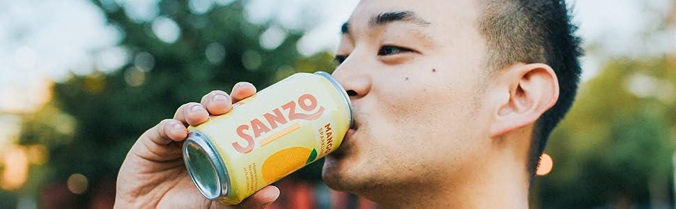 guy drinking mango sanzo