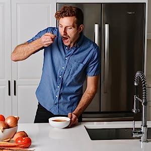 man eating soup
