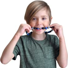 Boy wearing Munchables Navy Camo Chew Necklace