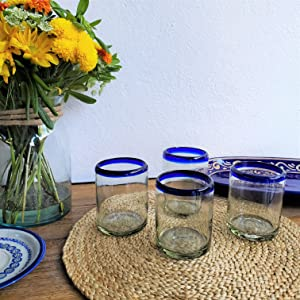 Four Cobalt Blue Rim Tumblers in a table setting with Mexican Talavera plates and vase with flowers