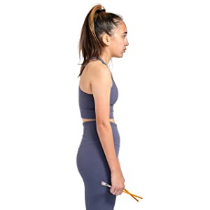 Female from the side holding pencils to that point towards each other proving poor posture