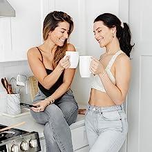 two girls coffee using August + Monroe spot treatment white coffee mugs