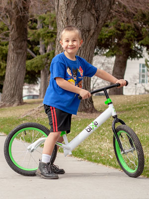boy on large balance bike for kids 5 to 9 years