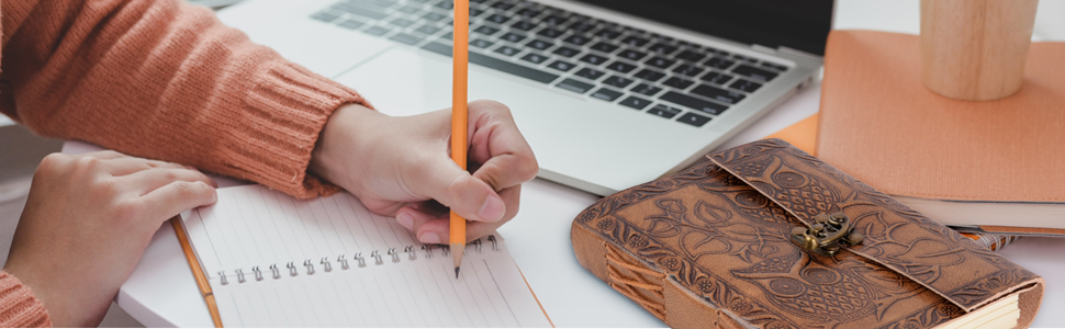 creative footer on desk leather journal lifestyle