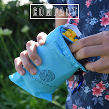 A boy taking the ECCOSOPHY pocket blanket out of it's pouch
