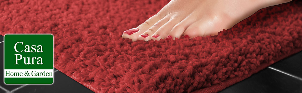 casa pura home and garden logo - close up of Ladies foot sinking into plush red bathmat - Sky Soft