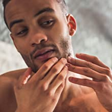The model of Boldnine men's natural face cleanser for sensitive skin uses also shave cream for men