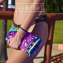 Girl holding compact ECCOSOPHY microfiber towel.