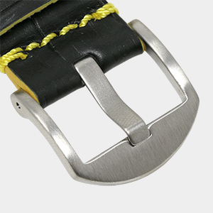 closeup of thick croc leather watch strap showing brushed silver thumbnail buckle