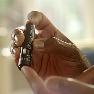 Woman using Accu-Chek Softclix lancing device