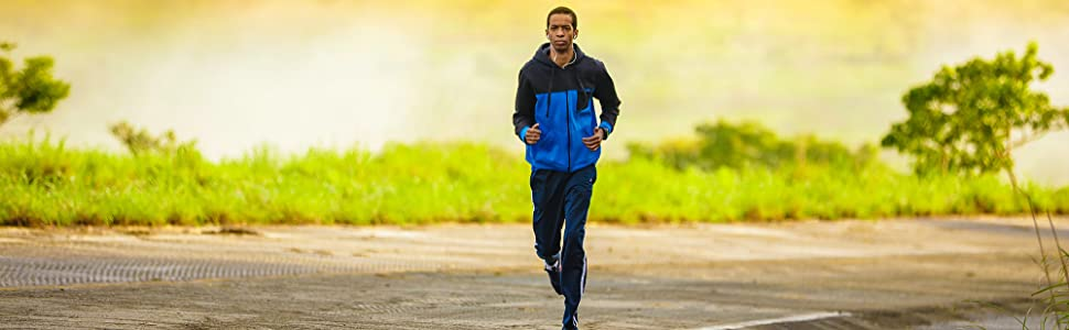 Male runner on a rural road