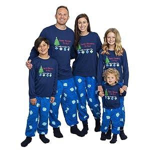 Family wearing matching set of pajamas.